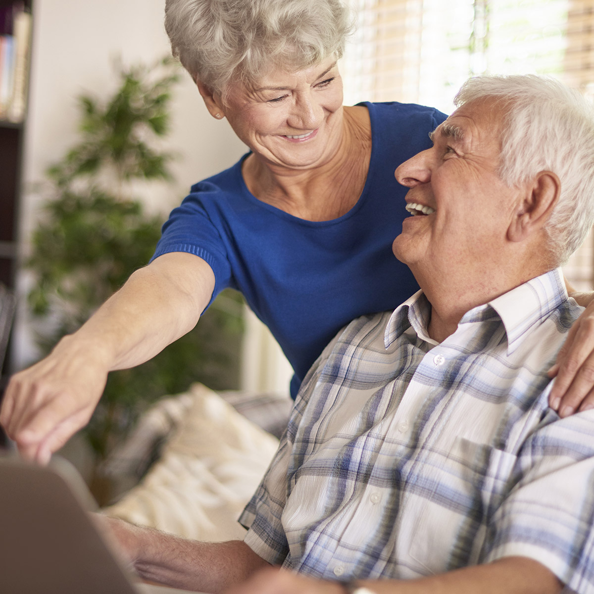 Couple shopping for stairlifts online